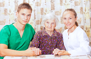 Older woman with caregivers